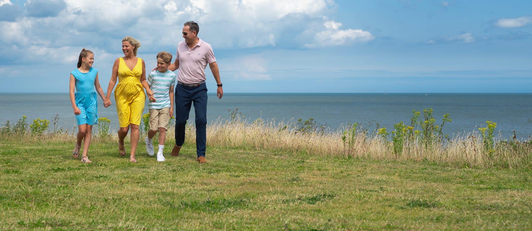 Family walking by the coast