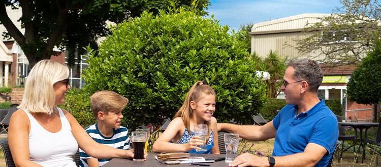 Family enjoying drinks in the sun