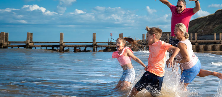 Family splashing in the sea