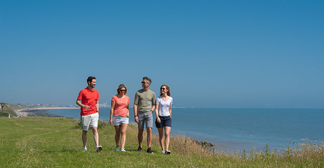 Group walking along the coast