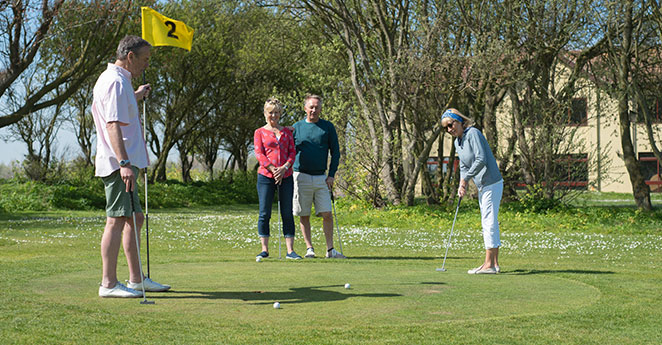Group playing golf