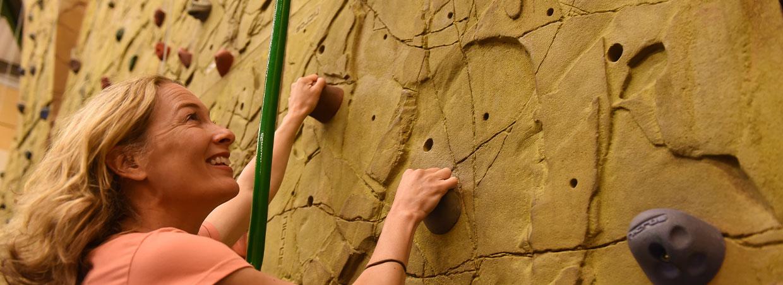 Woman climbing a climbing wall